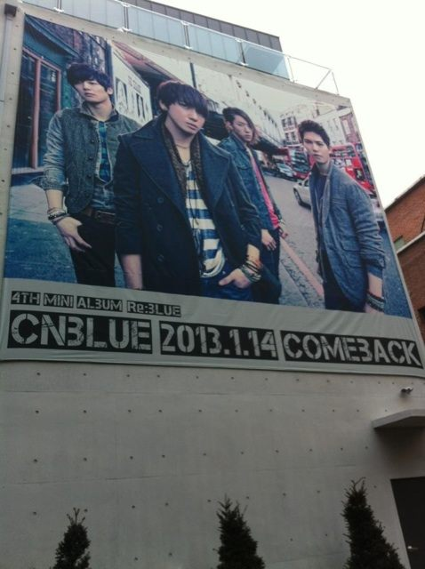 CNBLUE poster on FNC building